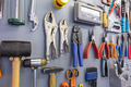 Assorted work tools on garage wall - PhotoDune Item for Sale