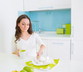 Young beautiful woman eating on kitchen - PhotoDune Item for Sale