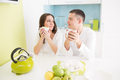Young beautiful couple eating on kitchen - PhotoDune Item for Sale