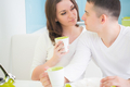 Young beautiful couple drinking tea on kitchen - PhotoDune Item for Sale