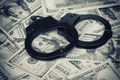 Handcuffs on money - PhotoDune Item for Sale