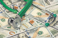 heap of dollars with stethoscope - PhotoDune Item for Sale