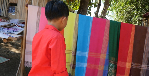 Kid Looking At Textile