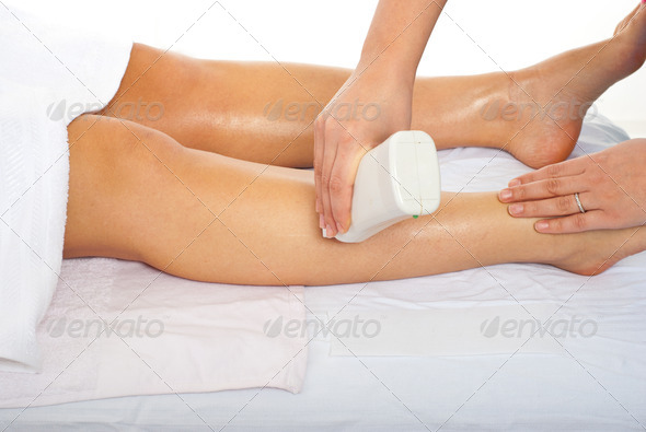 PhotoDune Beautician waxing woman leg 1077802
