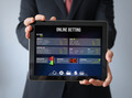 businessman with bet online tablet - PhotoDune Item for Sale
