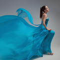 Beautiful Woman In Fluttering Airy Blue Dress. Gray Background. - PhotoDune Item for Sale