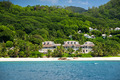 View of Seychelles coastline with a house in the forest - PhotoDune Item for Sale