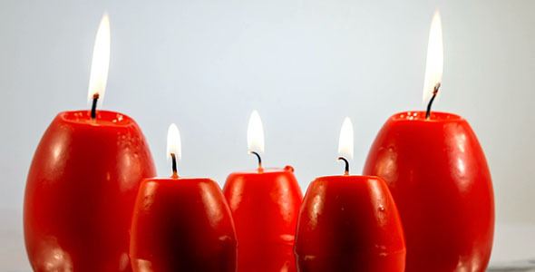Red Easter Egg Shape Candles Burning