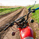 Classic old motorcycle on a dirt road. - PhotoDune Item for Sale