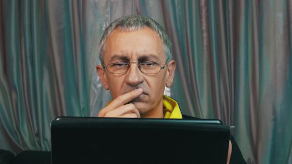 Portrait Dissatisfied Man Reading a Tablet