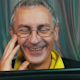 Laughing Man in Glasses Reading a Tablet - VideoHive Item for Sale