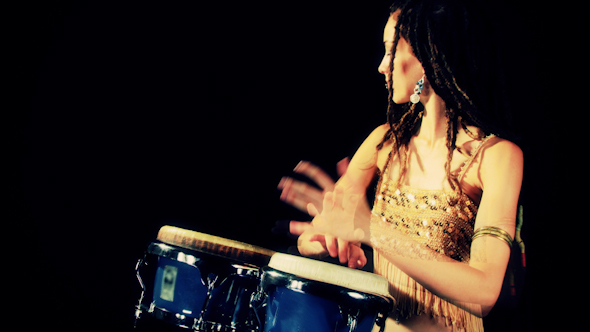 Beautiful Female Percussion Drummer Performing With Bongos 10