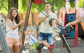 Daughters on swings with parents - PhotoDune Item for Sale