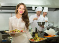 Female waiter taking dish at kitchen - PhotoDune Item for Sale