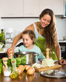 Mother with little daughter cooking at home - PhotoDune Item for Sale