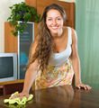 woman dusting wooden table - PhotoDune Item for Sale