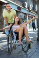 Husband taking spouse on wheelchair - PhotoDune Item for Sale