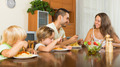 happy family of four  having lunch - PhotoDune Item for Sale