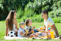 Family of four having picnic - PhotoDune Item for Sale
