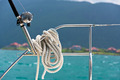 A rope tied around a lifeline and a fishing rod on a yacht - PhotoDune Item for Sale