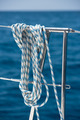 A rope tied around a lifeline on a yacht - PhotoDune Item for Sale
