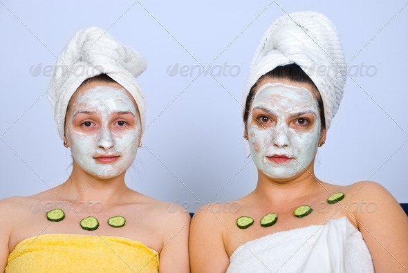 Portrait of women with facial mask - Stock Photo - Images