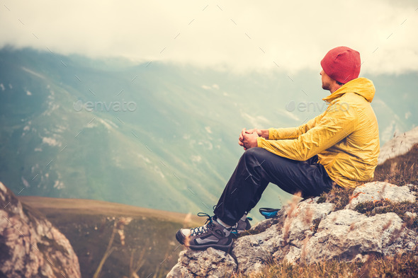 Man Traveler relaxing alone in Mountains Travel Lifestyle concept