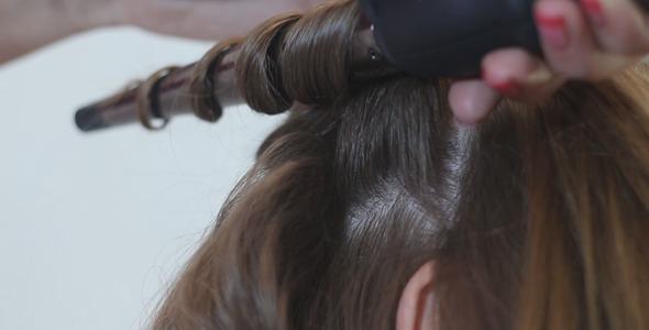 Stylist Twists Hair Girl