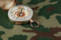 Compass on a camouflage background - PhotoDune Item for Sale