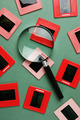 old slides and a magnifying glass on green table - PhotoDune Item for Sale