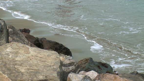 VideoHive Waves Hit A Quiet Beach 10749400