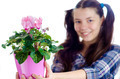 Girl Holding Pot of Pink Flowers - PhotoDune Item for Sale