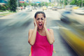 Portrait business woman screaming at street car traffic - PhotoDune Item for Sale