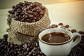 Roasted coffee beans and hot coffee - PhotoDune Item for Sale