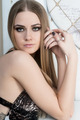 Portrait of young pretty blond woman in studio - PhotoDune Item for Sale