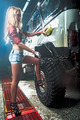 Attractive sexy young woman washes offroad car by foam hose - PhotoDune Item for Sale