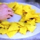 Nachos being Spread on a Cooking Sheet - VideoHive Item for Sale