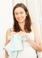 pregnant woman who knitted baby clothes - PhotoDune Item for Sale