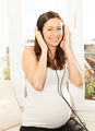 happy pregnant woman listening to music - PhotoDune Item for Sale