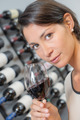Brunette smelling a glass of red wine - PhotoDune Item for Sale