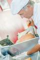 Butcher slicing ham - PhotoDune Item for Sale