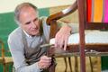 Repairing a chair - PhotoDune Item for Sale