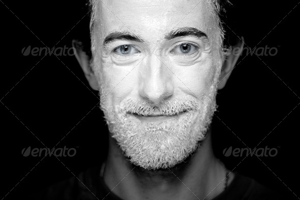 A man with makeup on his face - Stock Photo - Images