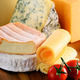 Different sorts of cheese isolated on kitchen table - PhotoDune Item for Sale