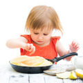 baby girl with pancakes - PhotoDune Item for Sale