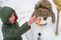 Snowman and child in the yard - PhotoDune Item for Sale