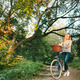 Young blonde woman on a vintage bicycle - PhotoDune Item for Sale