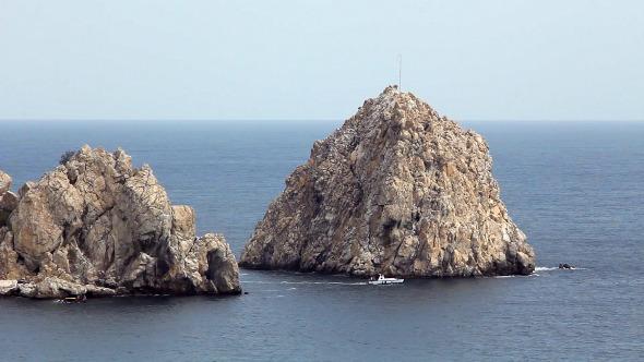 VideoHive Motorboat in Blue Sea Near Cliffs 10827135