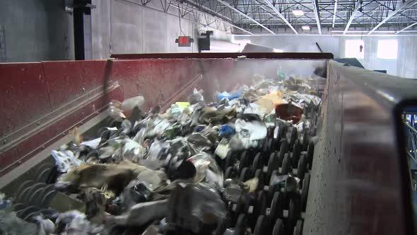 Trash On A Wheel Conveyor 2 Of 8