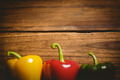 Three peppers on chopping board with copy space